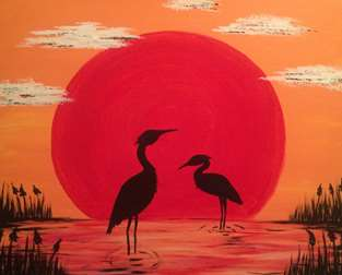Blue Herons and the Red Sun