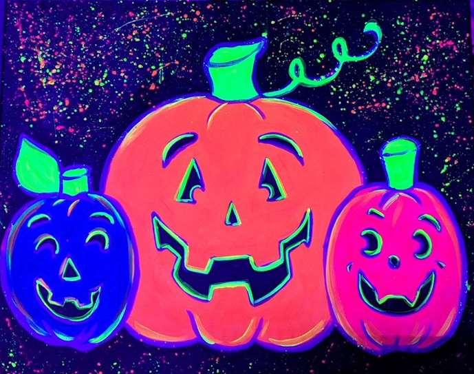 Glowing Jolly Jack-O-Lanterns (under blacklight)